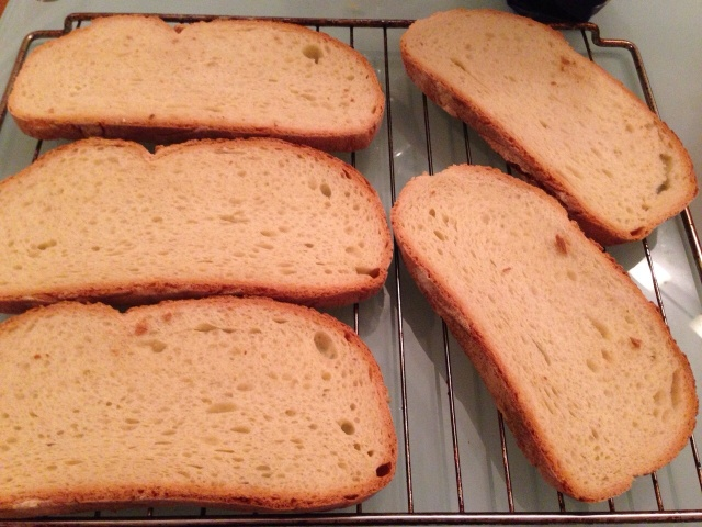 Take the bread and put it on the oven rack, and into the oven it goes to get toasted. About 5 minutes.