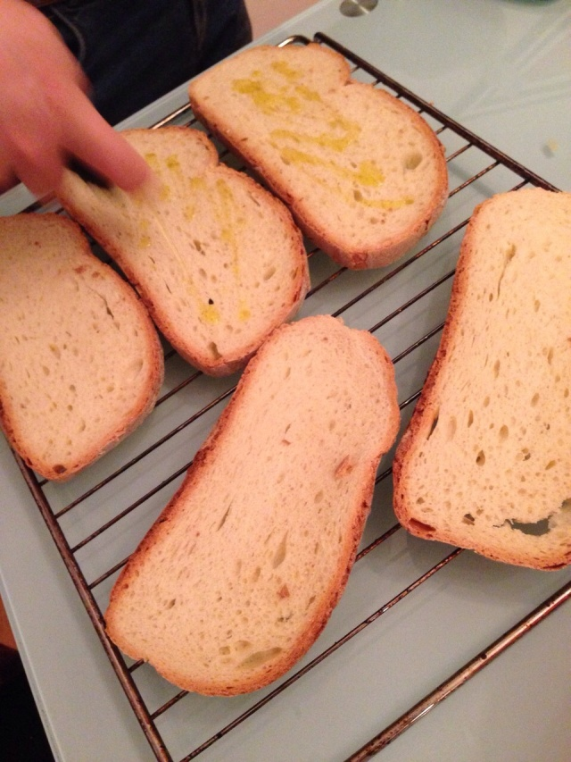 Before putting the bread in the oven, drizzle Olive Oil on each slice.